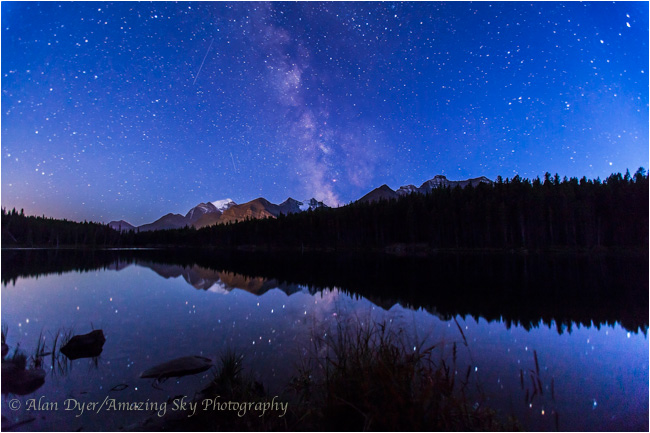 Milky Way in the summer twilight reflected in the still waters of Herbert Lake  by Alan Dyer ©