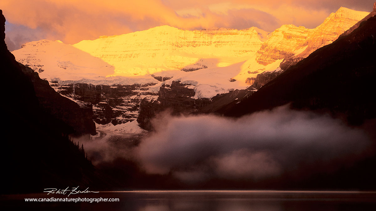 Lake louise in summer about 5 am - first light is hitting the glacier by Robert Berdan ©