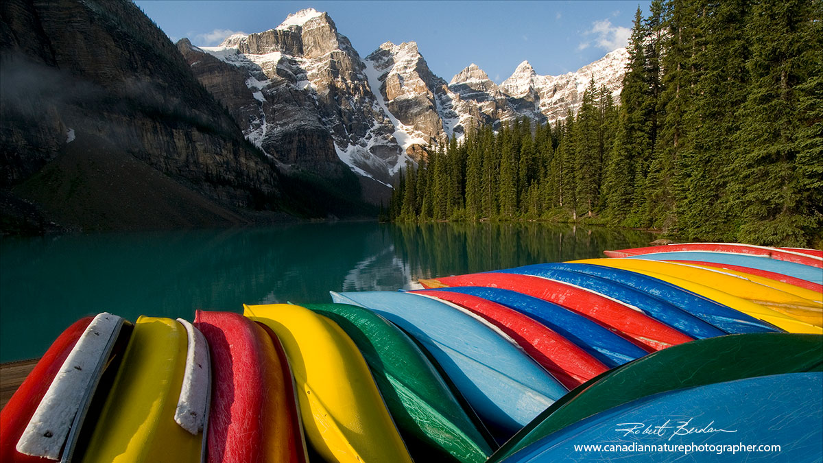 Canoes for rent on the boat docks at Moraine Lake by Robert Berdan ©