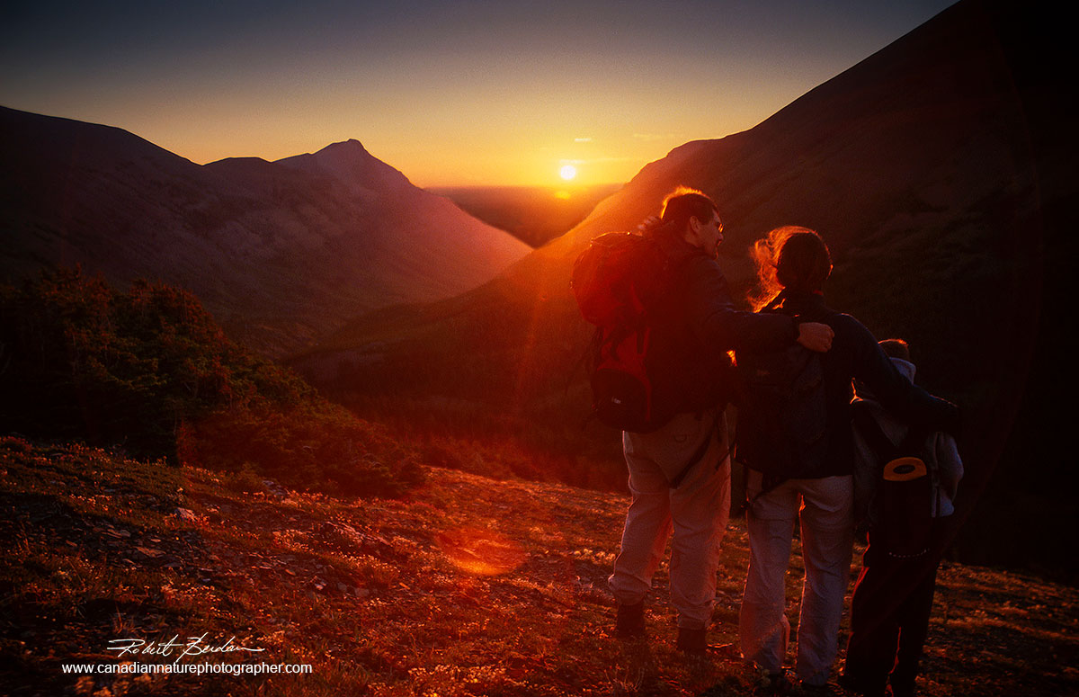 Family near the top of a mountain in the Castle Wilderness in South West Alberta at sunrise.Robert Berdan ©
