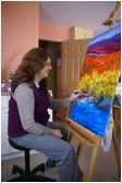 Ann Timmins painting in her Studio ©