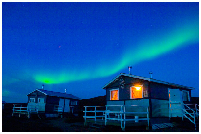 Aurora over cabins Peterson's Point Lake Lodge by Robert Berdan ©
