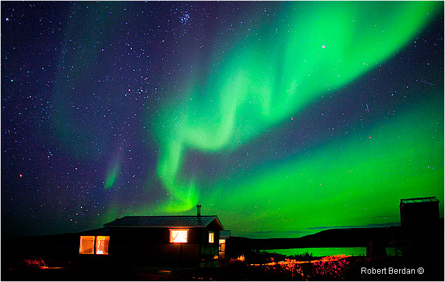 Aurora over cabins at Point Lake Lodge by Robert Berdan ©