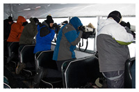 Photographers shooting out of tundra buggy by John Knight ©