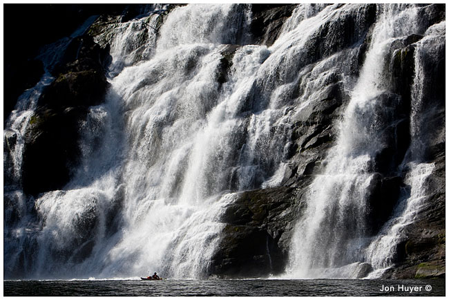 Kayker and enormous waterfall by Jon Huyer ©