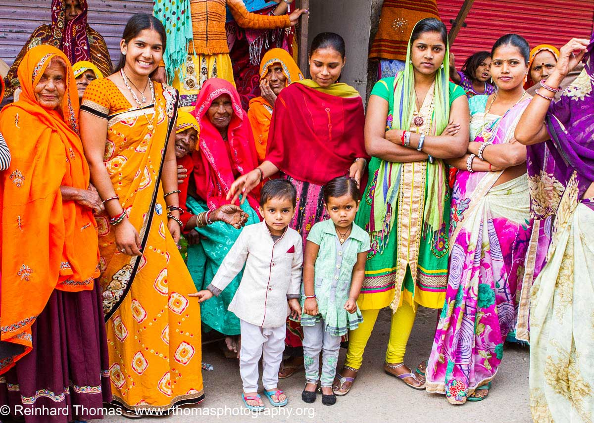 Three generations in colorfull dresses India by Reinhard Thomas ©