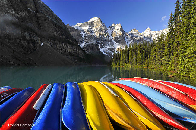 Canoes Moraine Lake Banff National Park by Robert Berdan