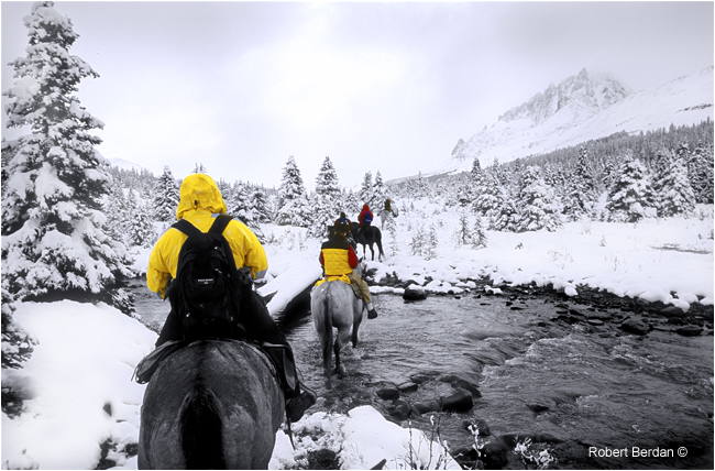 Riding out of the Tonquin Valley in a September snow storm by Robert Berdan ©