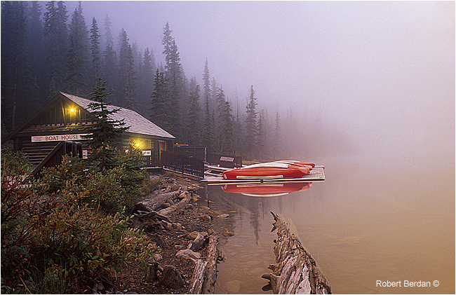 Boat house at lake louise in fog before sunrise by Robert Berdan ©