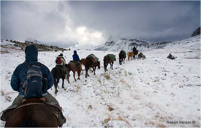 Riding on horseback out the Maccarib Pass after Autumn snowfall by Robert Berdan ©