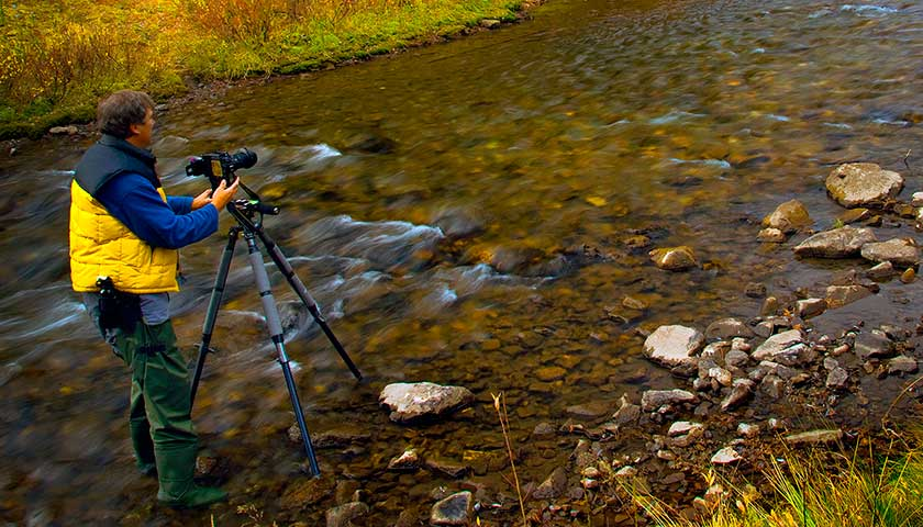 Robert Berdan in a creek photographing a panorama - self portrait