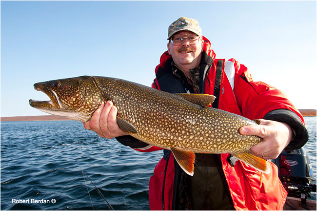 Egun Wuth holds Lake trout caught at point lake by Robert Berdan ©