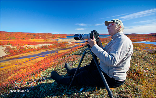 Photographer sits on top of Esker on the barrens by Robert Berdan ©