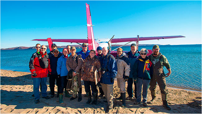 Peterson's point lake lodge guests group photo in front of Air Tindi plane on Point lake by Robert Berdan ©