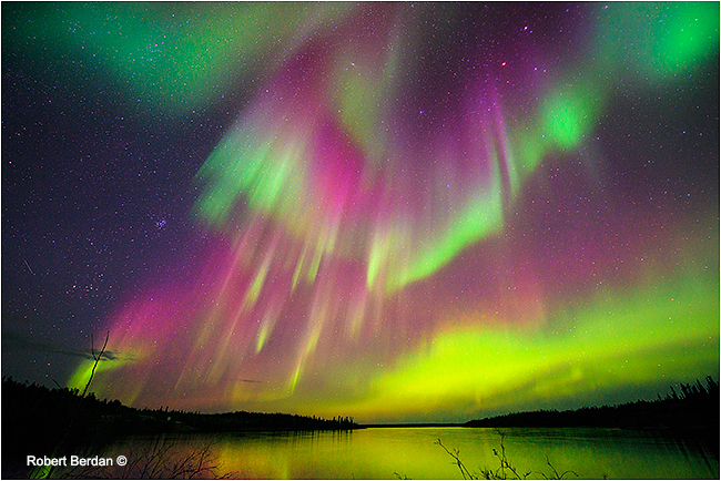 Crimison red aurora over Pontoon lake by Robert Berdan ©
