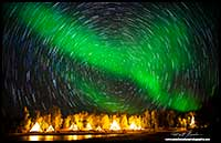Aurora Borealis and star trails over Aurora village Yellowknife, NT by Robert Berdan