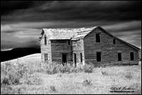 Black and white photo of abandoned home in Foothills of Alberta near Waterton by Robert Berdan