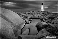 Black and white photo of Peggy's Cove Light house in Nova Scotia by Robert Berdan