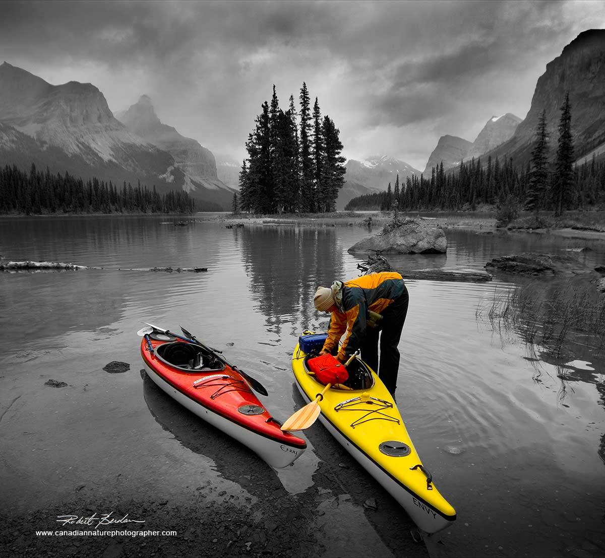 Bright colour of these kayaks pop out of the background which I made black and white to enhance the effect. Spirit Island, Jasper National Park, AB  by Robert Berdan ©