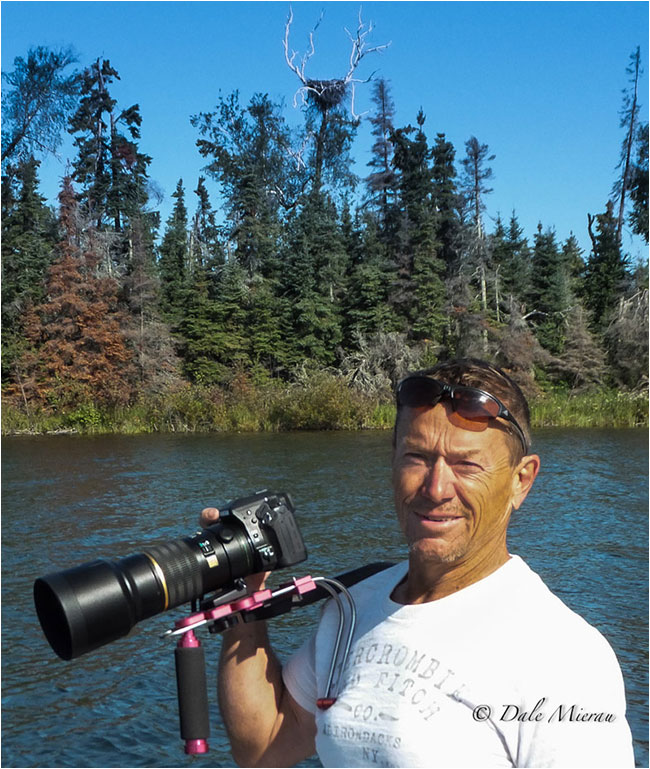 Dr. Dale Mierau with Camera and lens