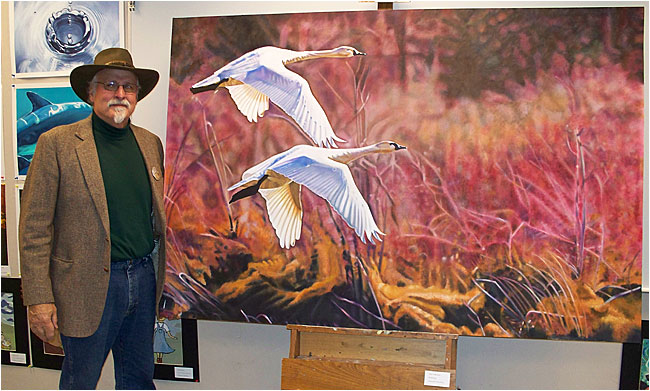Dan Feldhauser in front of his painting of Tundra Swans ©