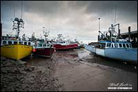 Alma Harbour Boats at low tide in New Brunswick by Robert Berdan
