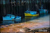 Boats at low tide New Brunswick by Robert Berdan