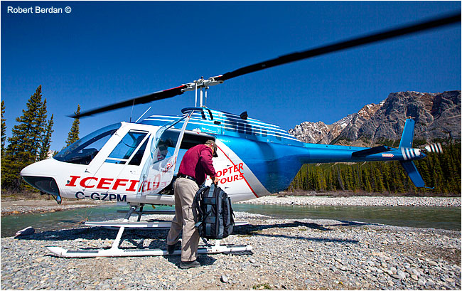 Gerry Weber lifts out camera bag from Helicopter by Robert Berdan ©