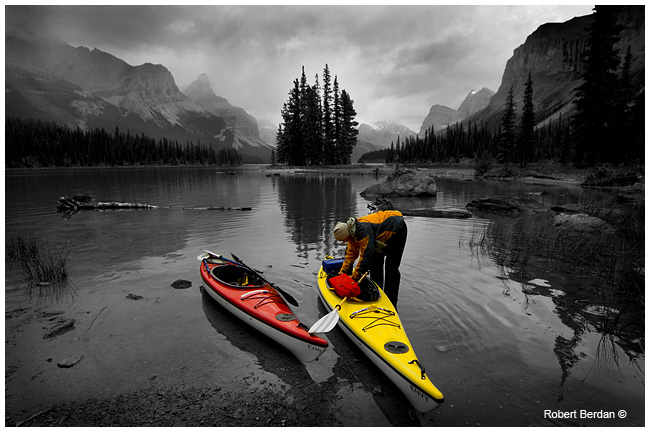 Kayaker unloading in front of Spirit Island, Jasper National Park, AB by Robert Berdan ©