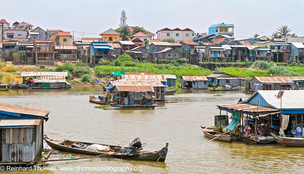 Village with floating houses by Reinhard Thomas ©