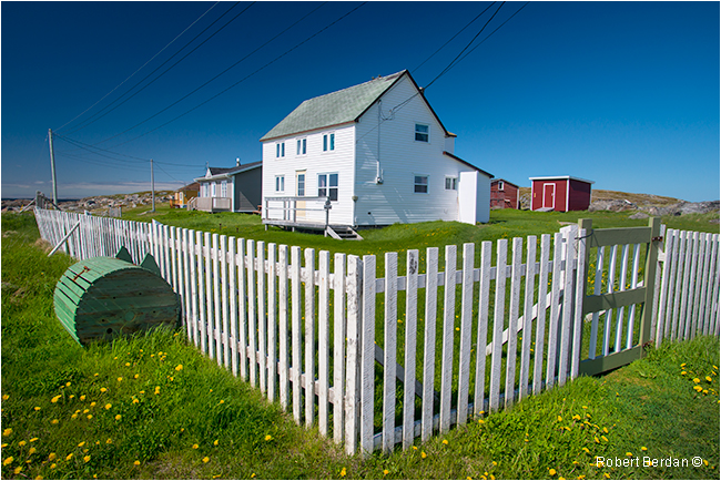 White picket fence and home in Tilting, Fogo Island Newfoundland by Robert Berdan ©