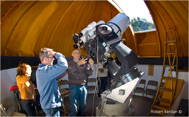 Jack Newton showing guests the sun in his observatory by Robert Berdan