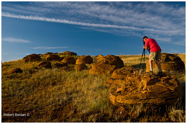 photographer taking picture of Red Rocks at Red Rock coulee by Robert Berdan ©