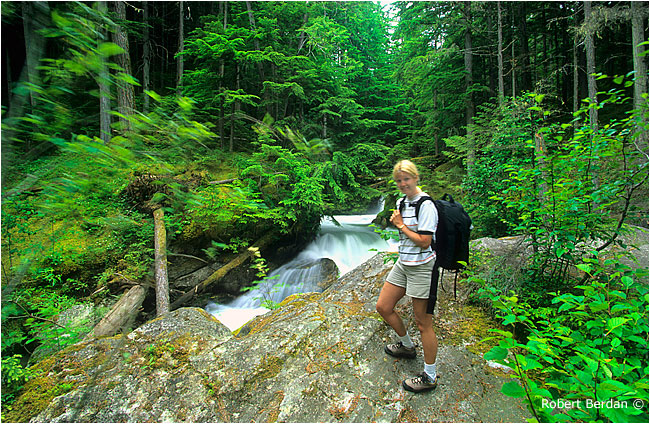 Hiker in front of Begbie creek by Robert Berdan ©