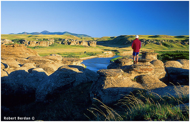 Hiker looks south at Writing-on-Stone Provincial Park by Robert Berdan ©
