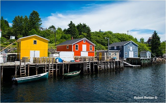 Small harbour north of Halifax with beautifully painted storage buildings by Robert Berdan ©