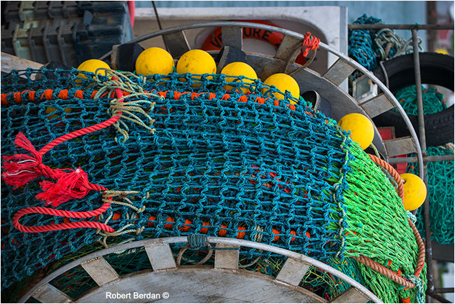 Fishing nets with colourful buoys by Robert Berdan ©