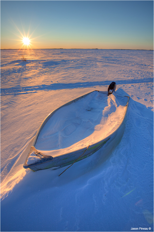 Boat in winter on shores of Lac Le Martre, NWT by Jason Pineau ©