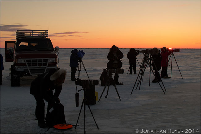 Photographers on the tundra packing up at sunset by Jon Huyer ©
