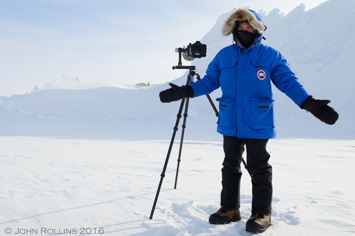 Jonathan Huyer with camera in front of polar bears by John Rollins ©