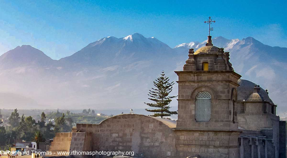 Arequipa church with volcano in the background by Reinhard Thomas ©