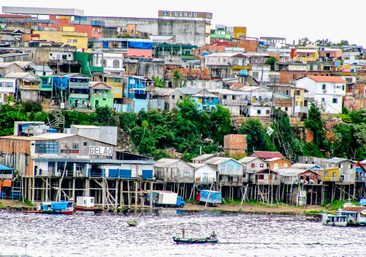 Houses on stilts along the river in Manaus by Reinhard Thomas ©