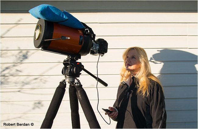Person viewing the partial solar exlipse through a telescope mounted with a camera by Robert Berdan ©