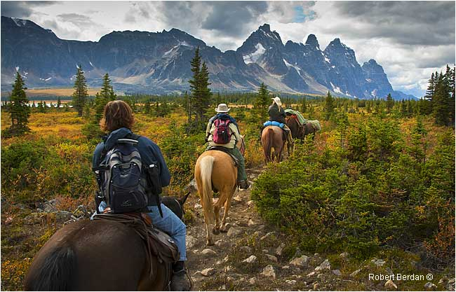 Riding horseback into the Tonquin Valley with the Ramparts in the background by Robert Berdan ©