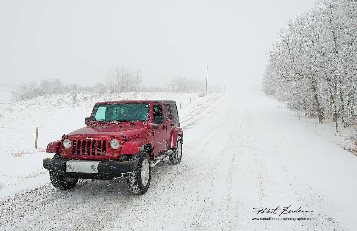 Jeep on winter road by Robert Berdan ©