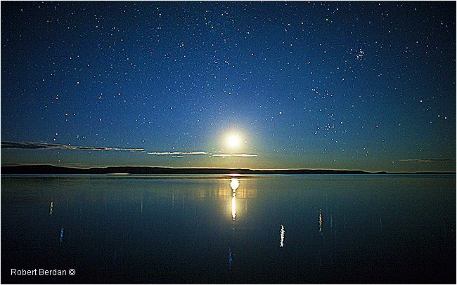 stars and moon over Point Lake NWT by Robert Berdan