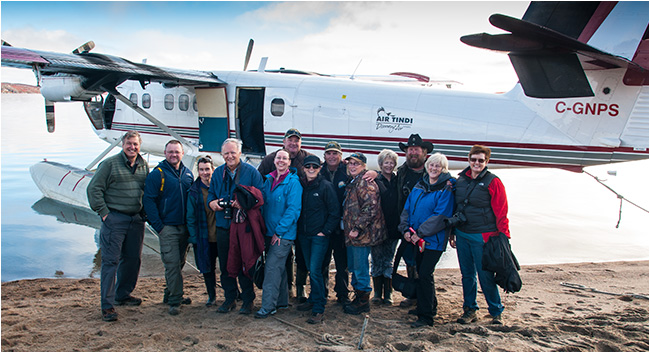 Photographers and guides in front of Air Tindi plane on Point Lake Peterson's Pint lake lodge by Robert Berdan ©