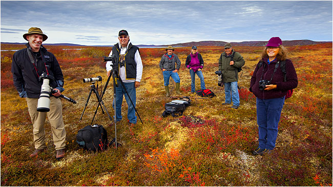 Photographers on the Tundra in a workshop at Petersons Point Lake Lodge by Robert Berdan