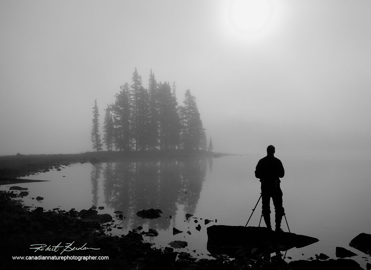 Silhouette of photographer at Spirit Island, Jasper National Park, AB at sunrise by Robert Berdan ©
