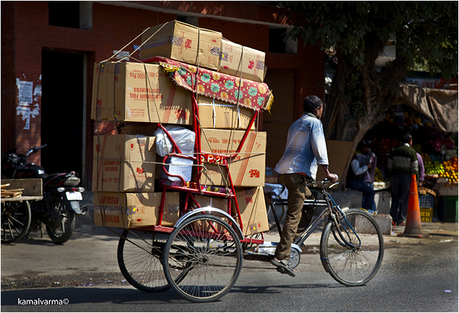Goods delivery on bike by Kamal Karma ©